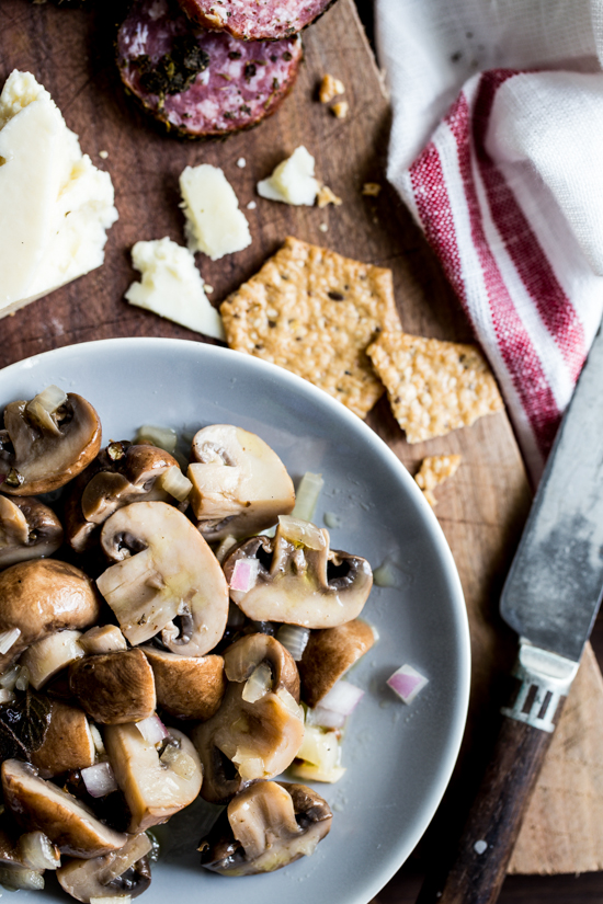 Marinated Mushrooms are a simple bite perfect for any holiday party!