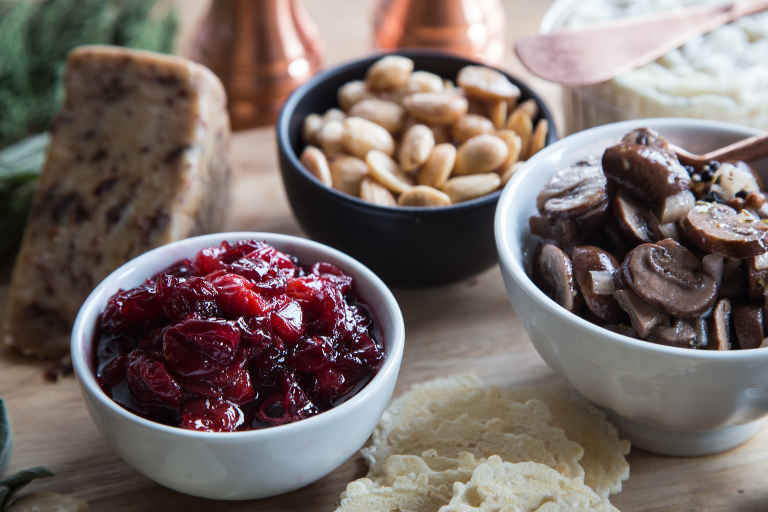 A Holiday Cheese Board needs a few extras to go with the cheese. Try marinated mushrooms, Tart Cherry Bourbon Compote, and salty Marcona almonds.