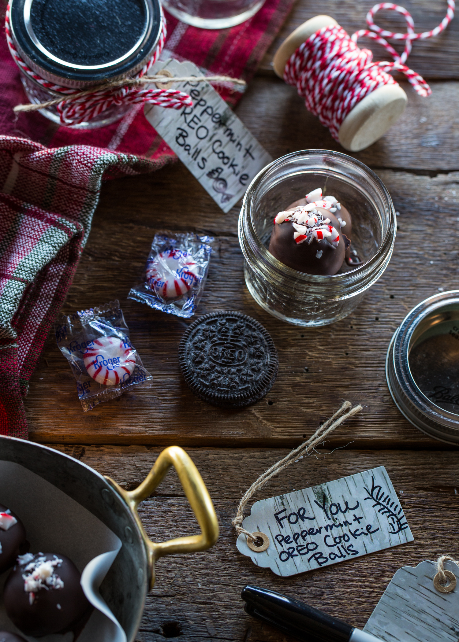 Peppermint OREO Cookie Balls make wonderful gifts when packaged in simple mason jars and decorated with ribbon. So cute!