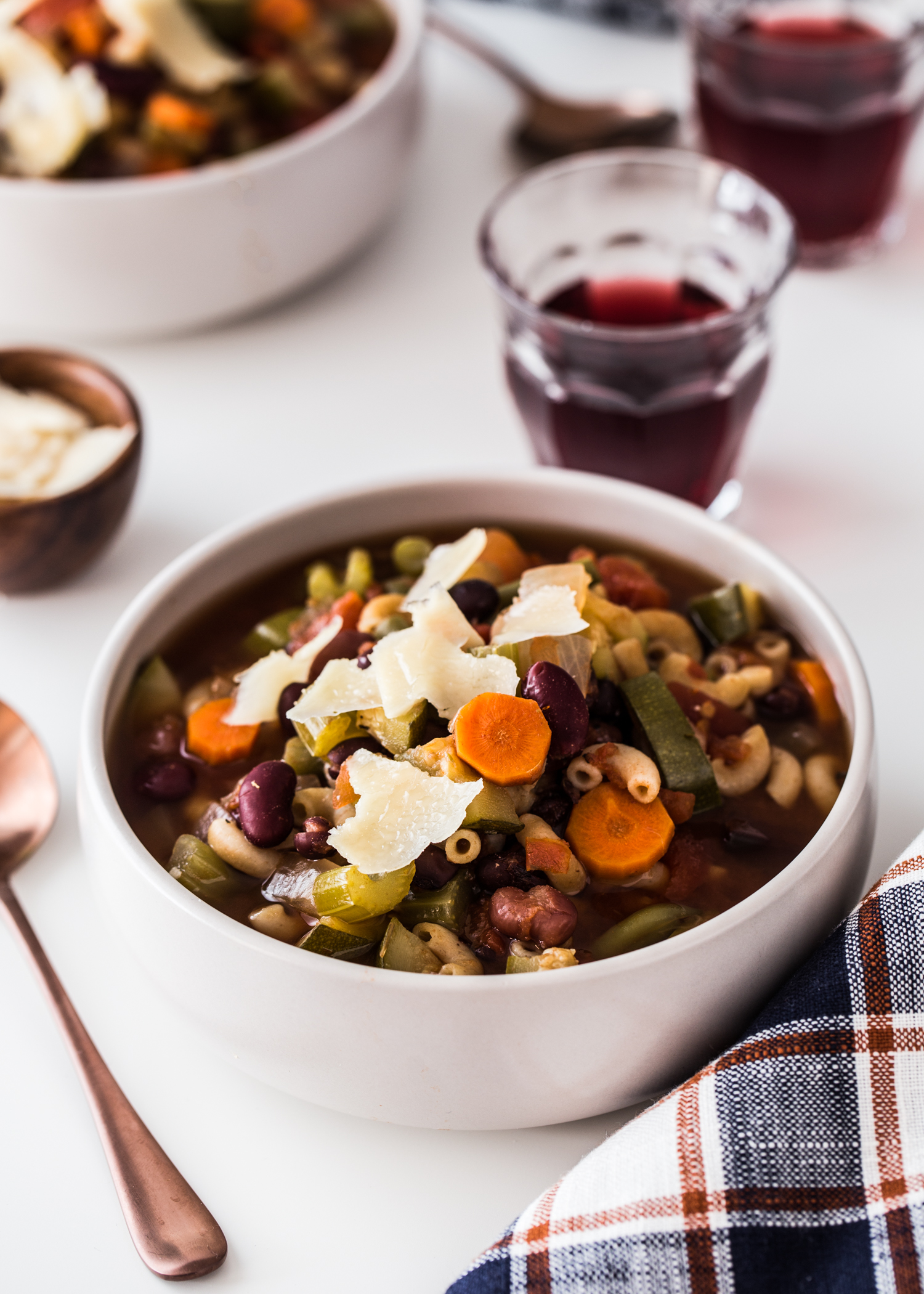 Slow Cooker Minestrone Soup full of vegetables, pasta, and topped with parmesan cheese