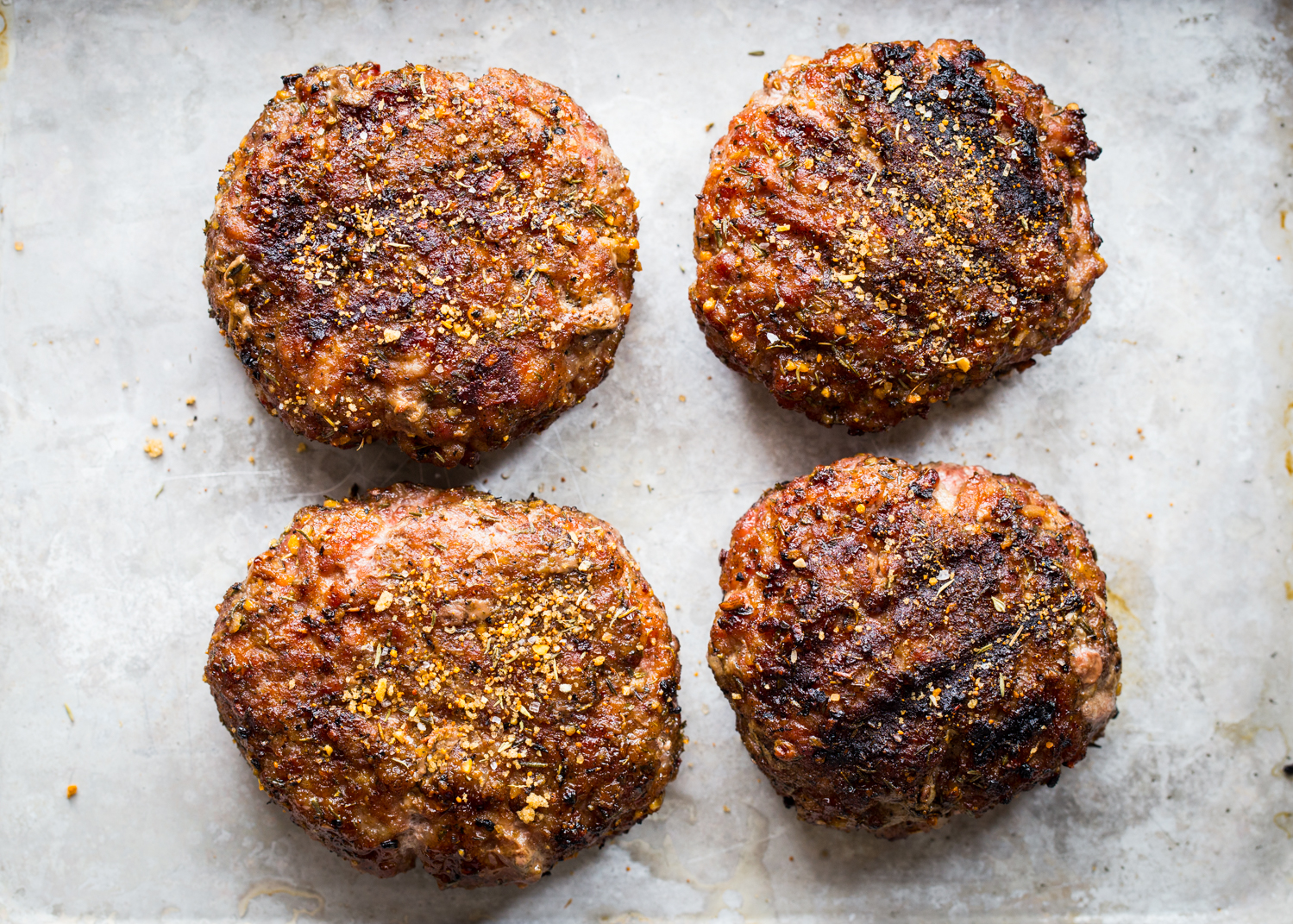 Smoky Maple & Sage Breakfast Pork Burgers made with ground pork and a kicking' seasoning rub!