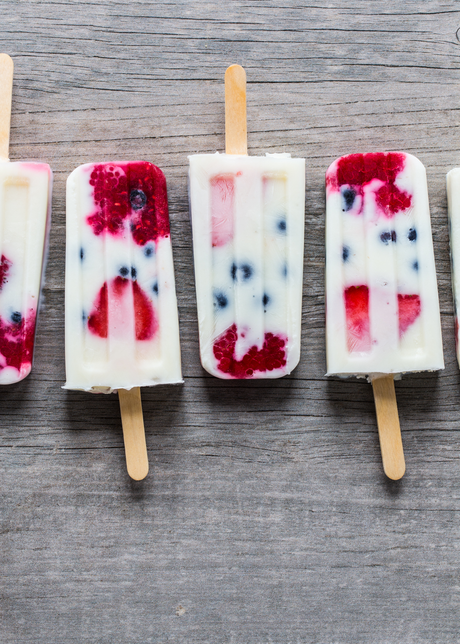 Creamy Vanilla Berry Popsicles made with milk, yogurt and fresh berries