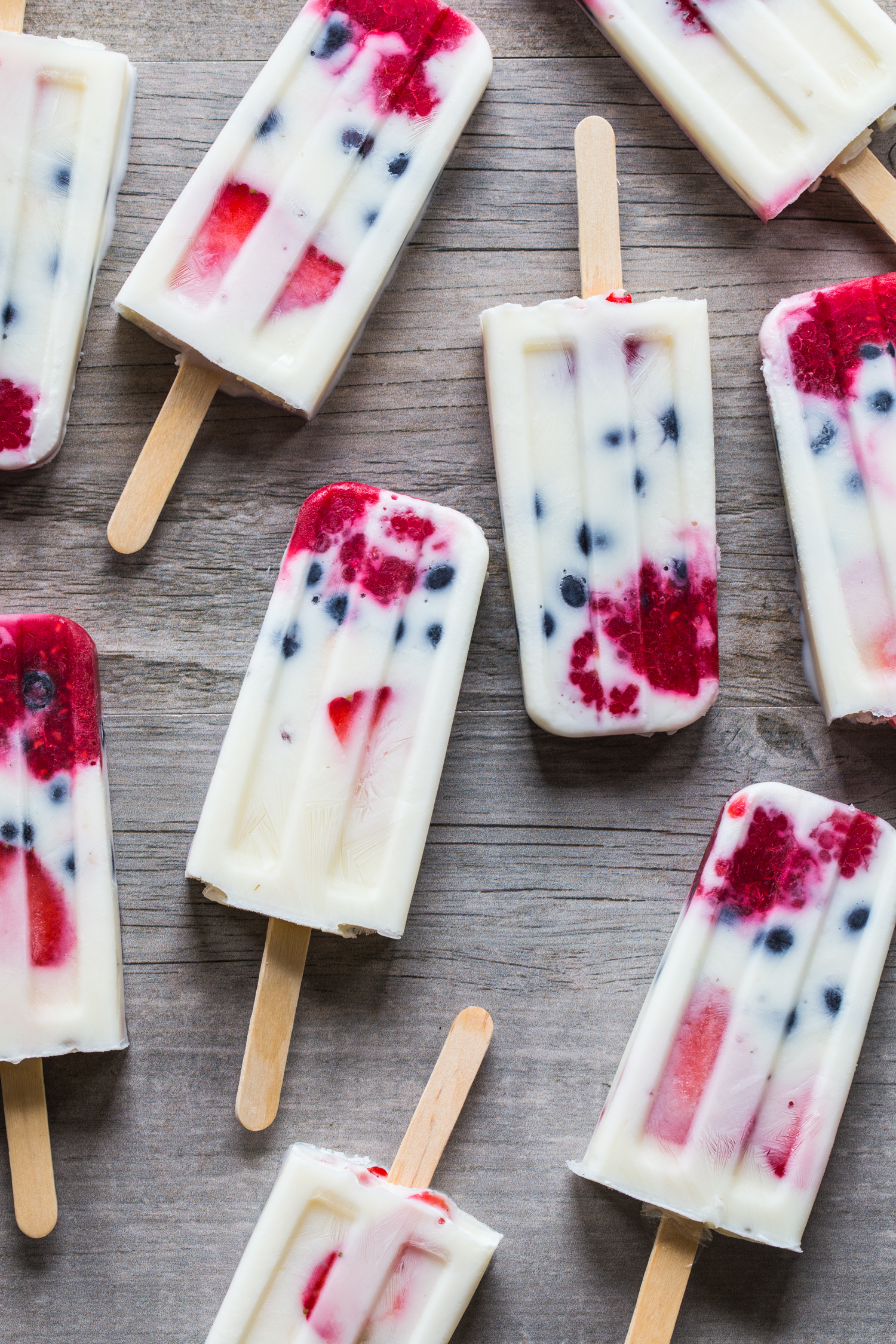 Creamy Vanilla Berry Popsicles made with wholesome milk, fresh berries, and vanilla yogurt