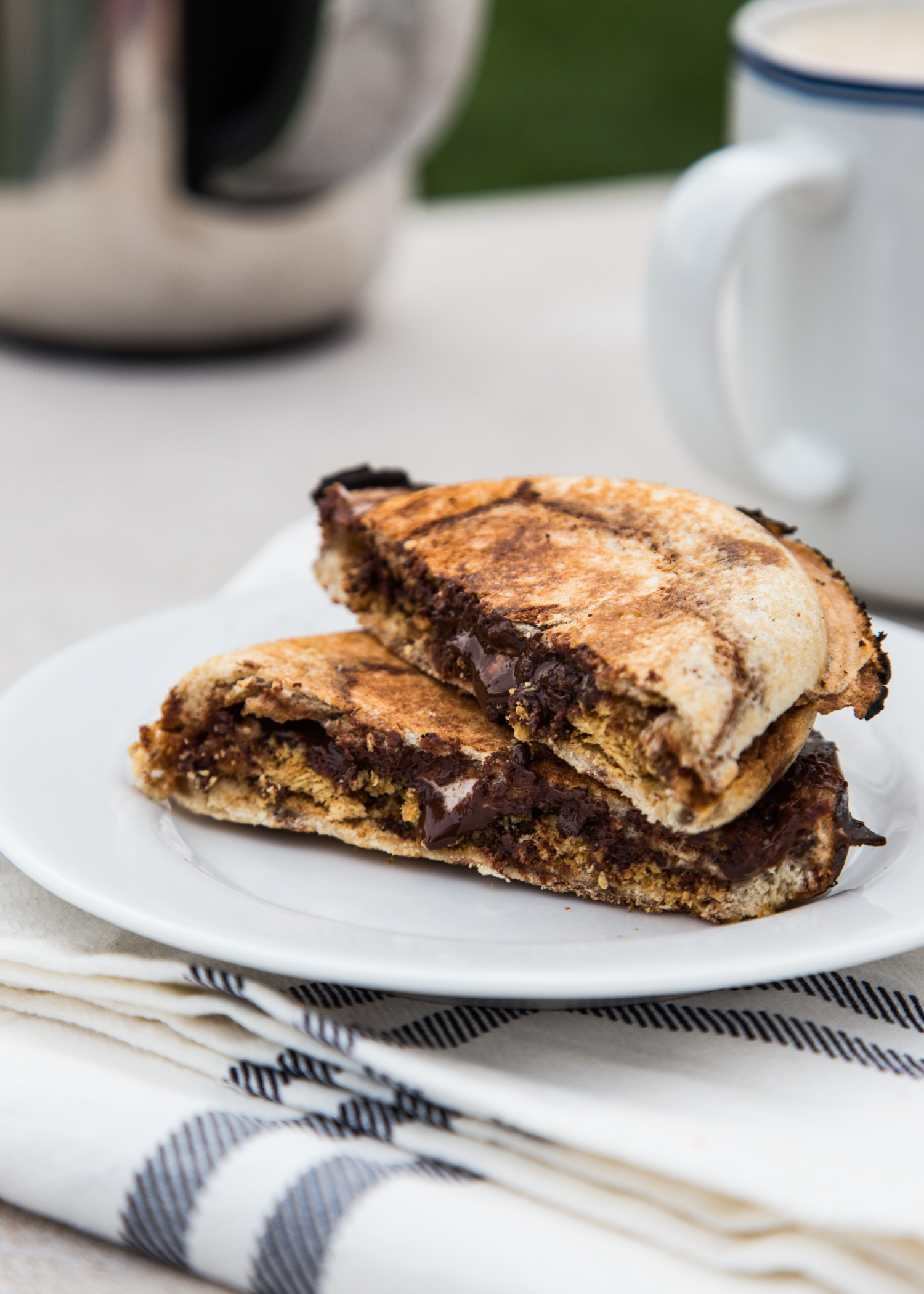 S'mores Pudgy Pies made with Campfire® Marshmallows, chocolate chips, crushed graham crackers all wrapped up in cinnamon swirl bread