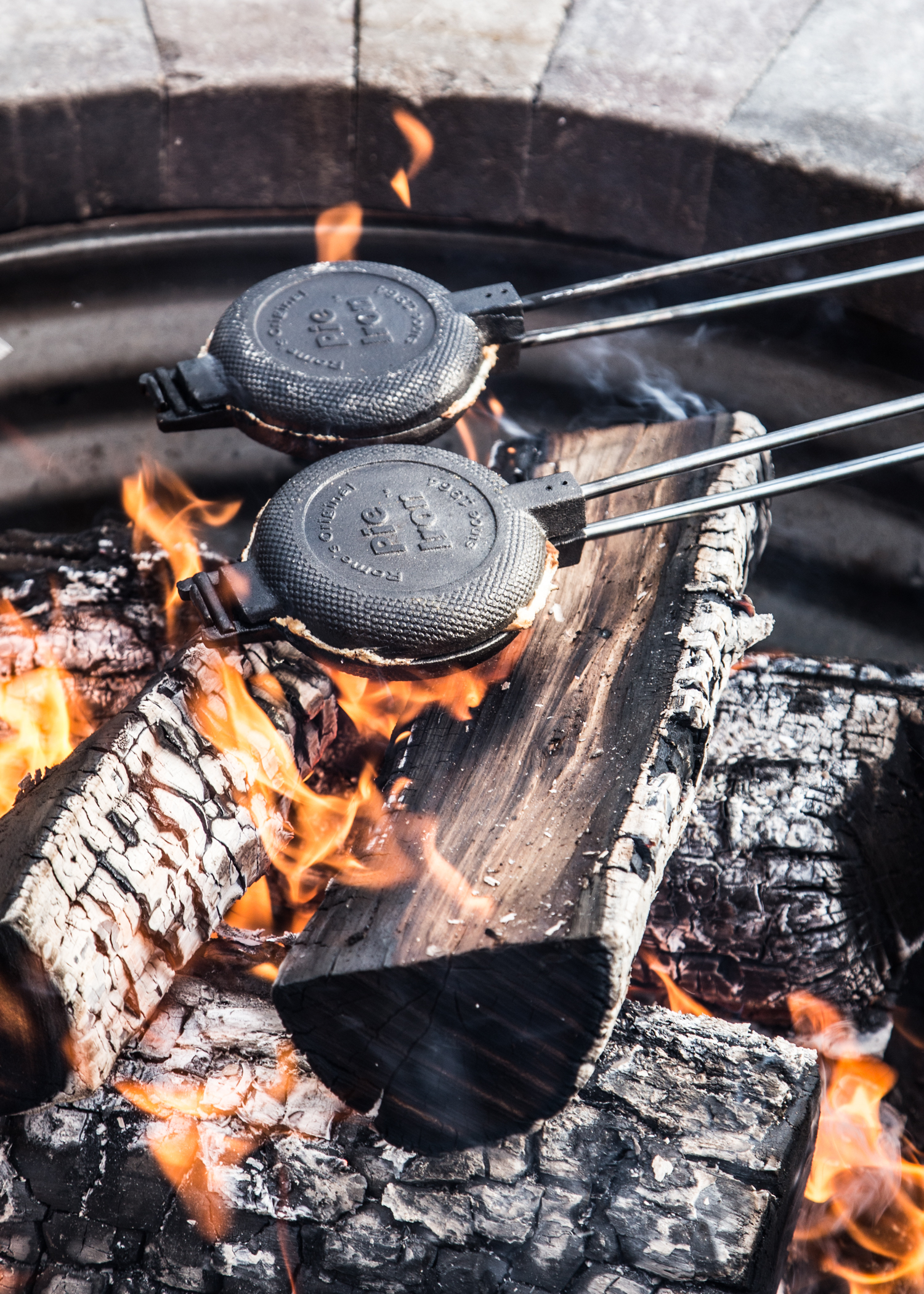 Roasting S'mores Pudgy Pies over campfire