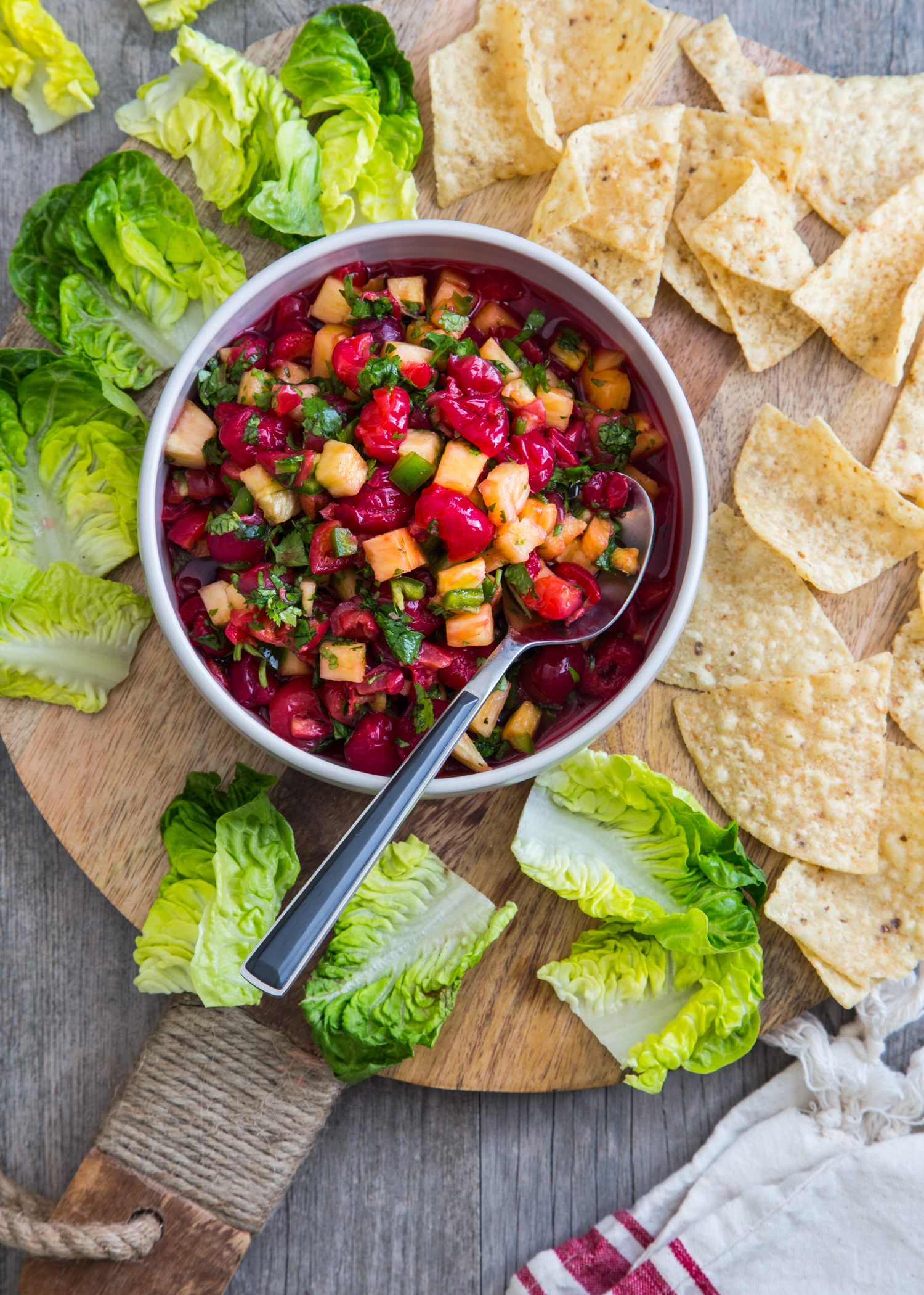 Montmorency Cherry Pineapple Salsa served with corn chips and lettuce cups for a great backyard bbq snack!