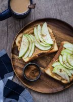 Apple Nut Butter Toast made with whole grain toast, nut butter, sliced apples, a drizzle of honey, and a pinch of cinnamon