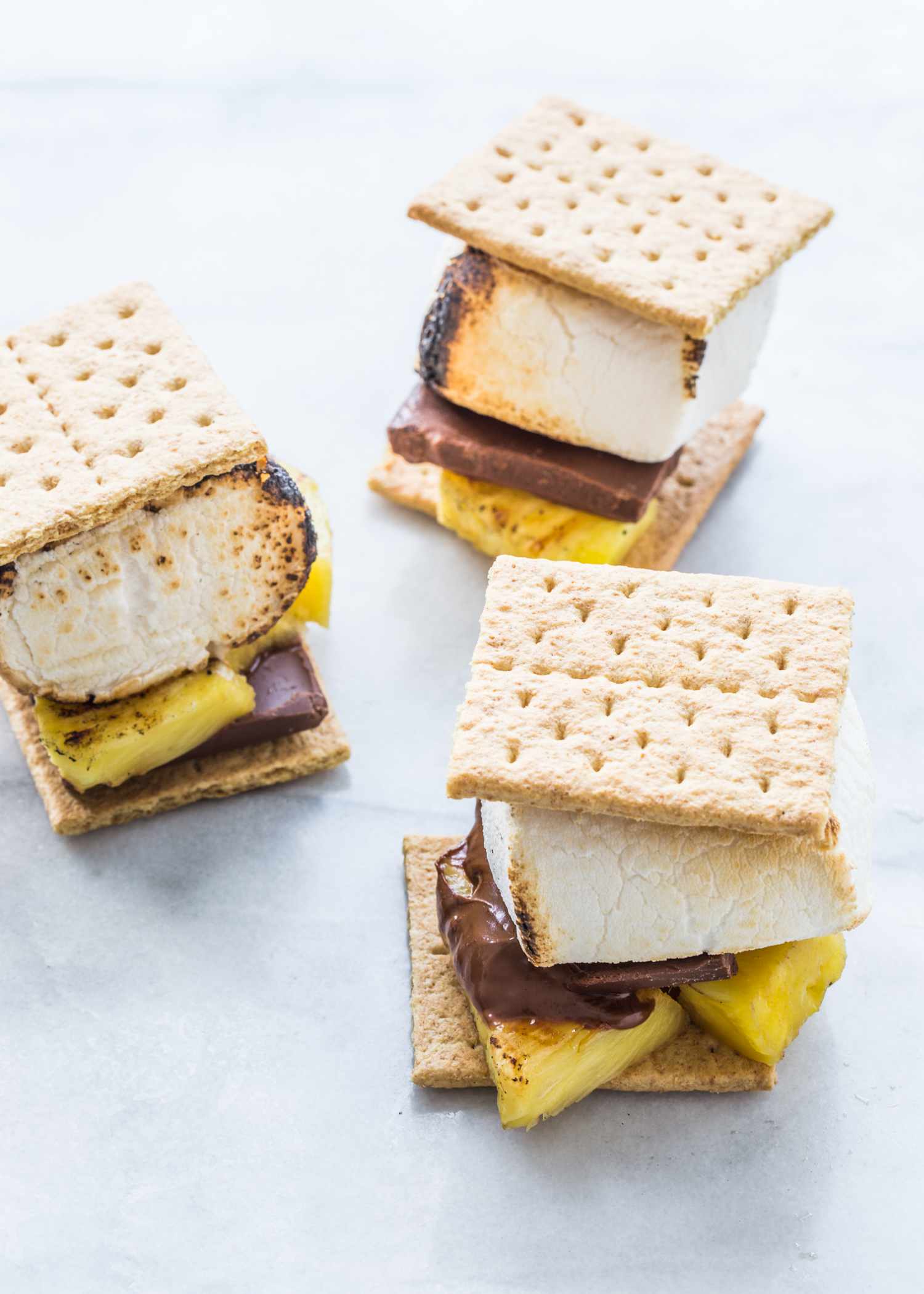 Grilled Pineapple S'mores with Campfire® Marshmallows, milk chocolate, and grilled pineapple