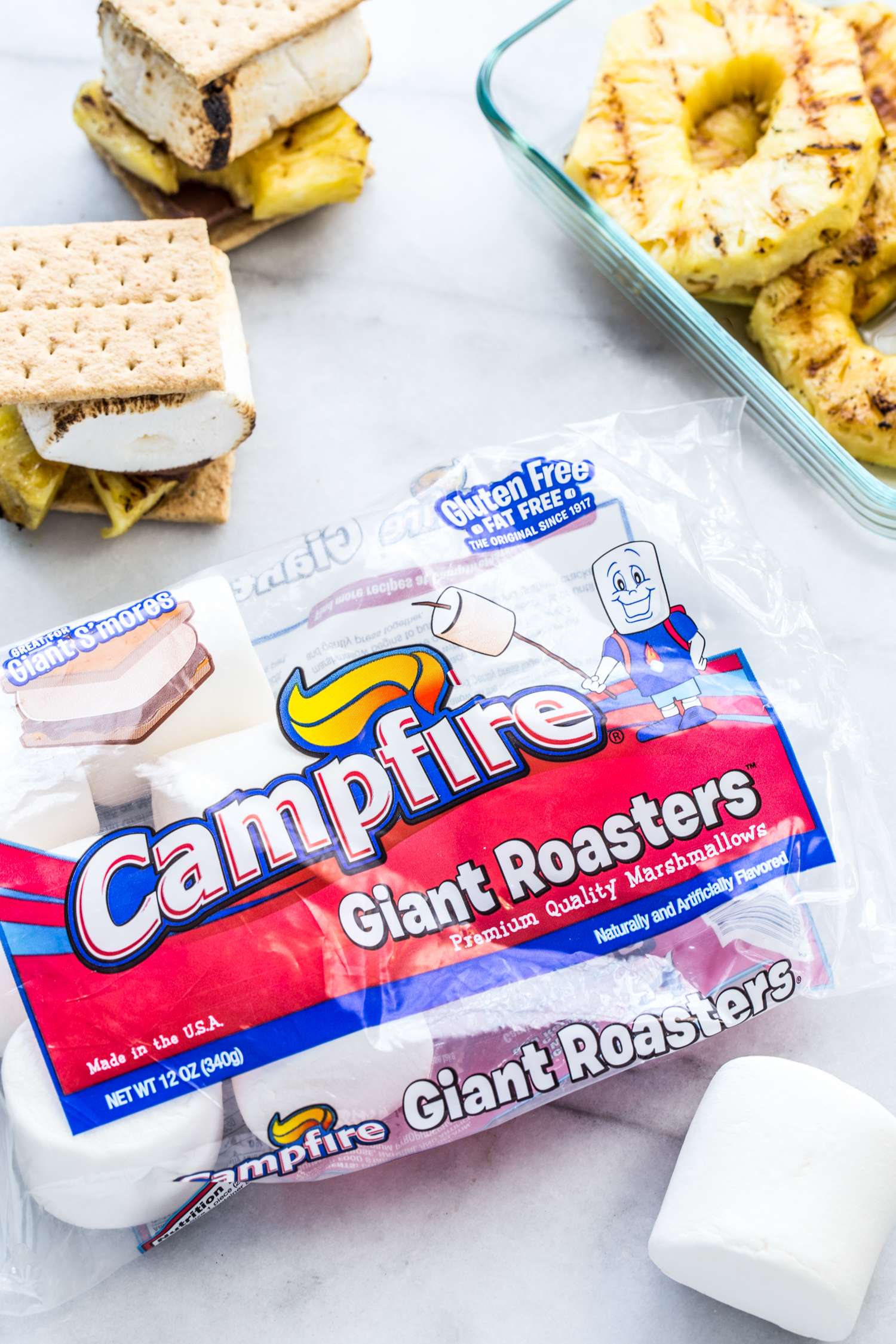 Grilled Pineapple S'mores with grilled pineapple, milk chocolate, and roasted Campfire® Giant Roaster Marshmallows + Recipe Video