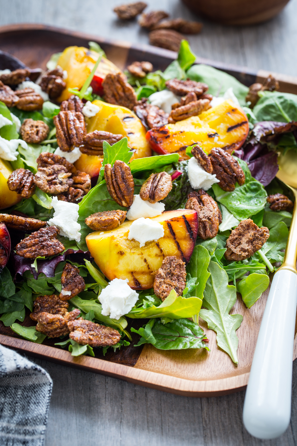 Spiced Pecan Grilled Peach Salad is a lovely summer salad topped with goat cheese and a simple vinaigrette