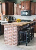 Exposed brick kitchen island with wooden countertop