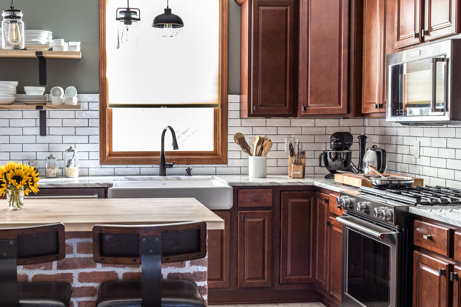 kitchen with white subway tile, black stainless, exposed brick, open shelves, black stainless kitchen renovation