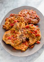 platter of pork chops with salsa