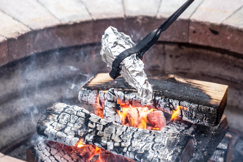 roasting smores cones over campfire