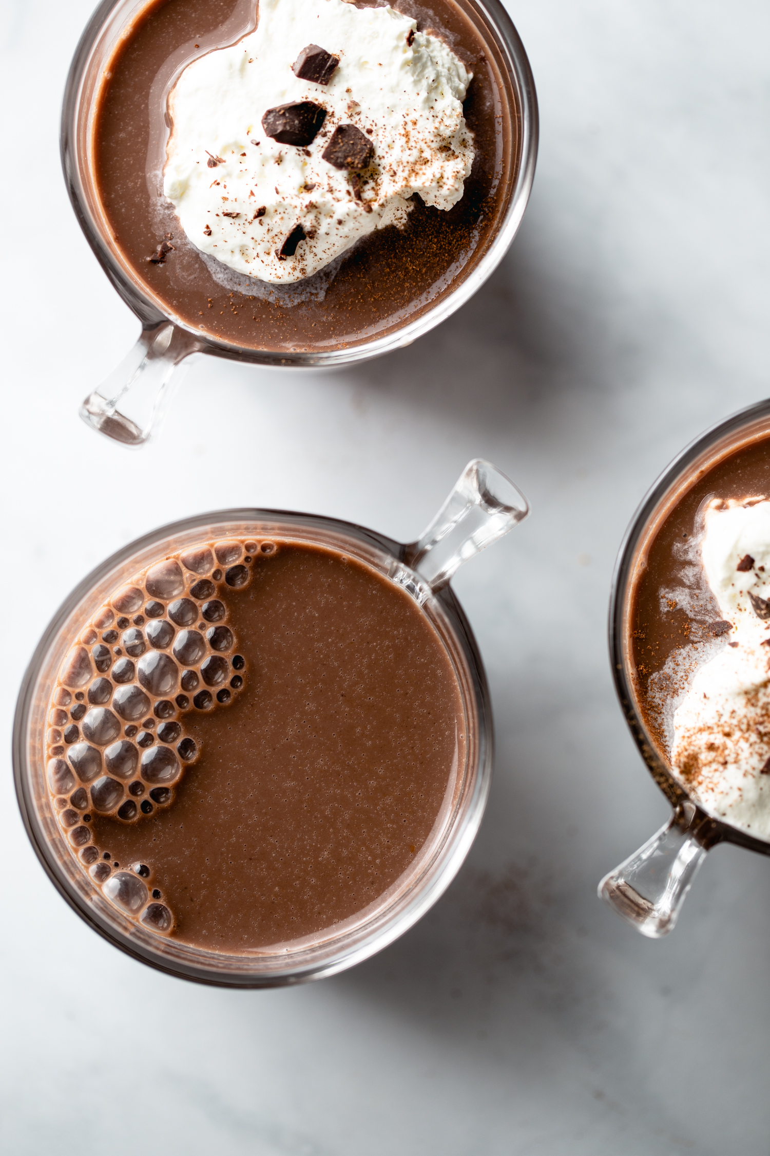 cups of hot chocolate on white background